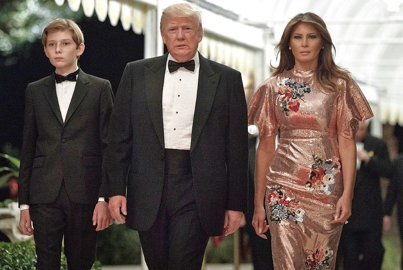 President Trump arrives for a New Year's Eve gala at his Mar-a-Lago resort with first lady Melania Trump and their son Barron